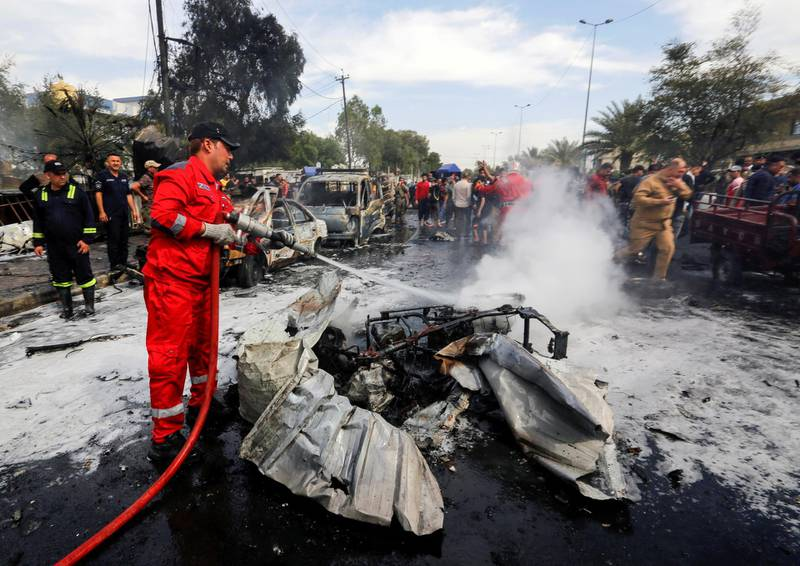 FILE PHOTO: A firefighter inspects the site of a car bomb attack in Sadr City district of Baghdad, Iraq April 15, 2021. REUTERS/Wissam al-Okili/File Photo