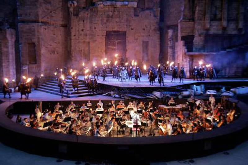 """The Opera chorus of Nice performs """"Lucia di Lammermoor"""", a three-act opera by Donizetti directed by Paul-Emile Fourny and Marco Guidarini, 26 July 2006 at the Antic theatre of Orange during the """"Orange Choregies"""" festival.   AFP PHOTO ANNE-CHRISTINE POUJOULAT"""