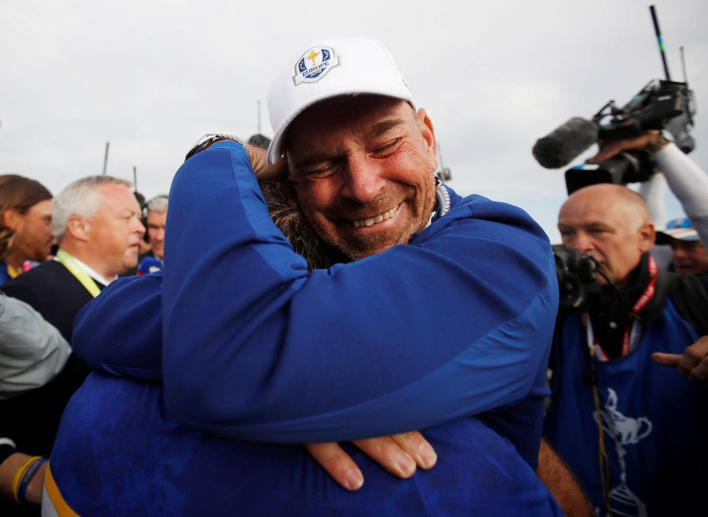 Golf - 2018 Ryder Cup at Le Golf National - Guyancourt, France - September 30, 2018. Team Europe's Francesco Molinari celebrates with captain Thomas Bjorn after winning the Ryder Cup REUTERS/Carl Recine      TPX IMAGES OF THE DAY