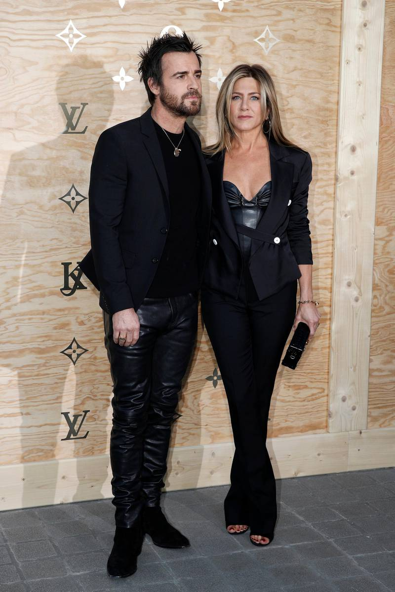 epa05903493 US actress Jennifer Aniston and US actor Justin Theroux arrives at the launch party by French fashion house Louis Vuitton of a new line of bags and accessories created by US artist Jeff Koons at the Louvre Museum in Paris, France, 11 April 2017. It is the first stage of Vuitton collaboration with Koons. Famous paintings works by Da Vinci, Titian, Rubens, Fragonard and Van Gogh have been transposed onto the canvas of bags.  EPA/YOAN VALAT