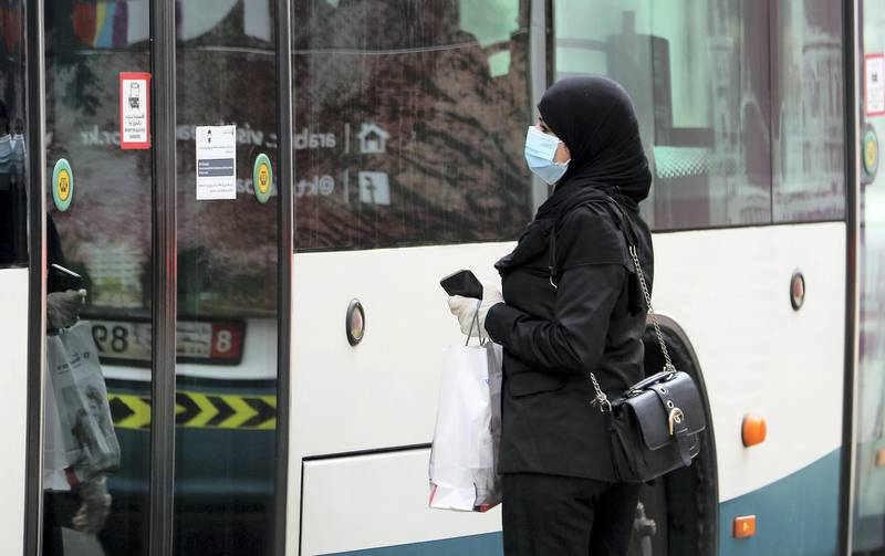 ABU DHABI, UNITED ARAB EMIRATES , June 1 – 2020 :- A woman wearing protective face mask as a preventive measure against the spread of coronavirus at the bus stop in Abu Dhabi. UAE government lifts the coronavirus restriction for the residents and businesses around the country. (Pawan Singh / The National) For News/Stock
