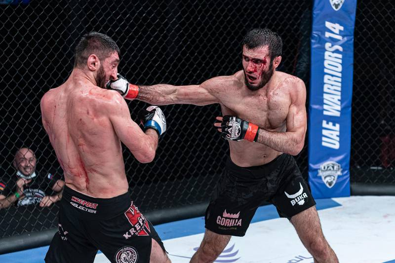 A bloodied Russian Islam Mamedov lands one on Martun Mezhulmyan of Armenia but the latter went on to win the Catchweight 73kg fight. Courtesy Palms Sports