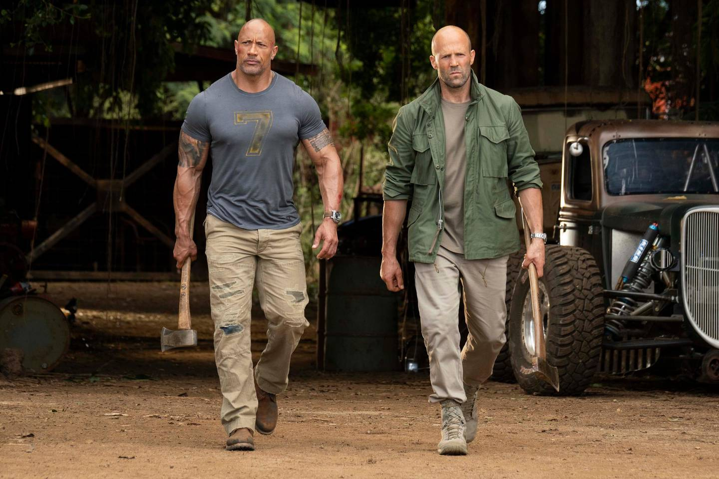 """(from left) Luke Hobbs (Dwayne Johnson) and Deckard Shaw (Jason Statham) in """"Fast & Furious Presents: Hobbs & Shaw,"""" directed by David Leitch. Courtesy Universal Pictures"""