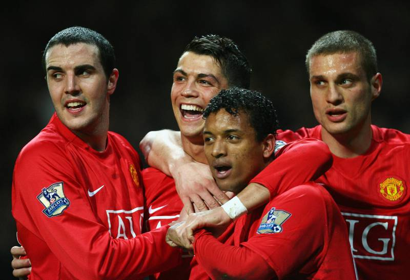 MANCHESTER, UNITED KINGDOM - MARCH 19:  Cristiano Ronaldo of Manchester United (2L) celebrates with team mates John O'Shea (L), Luis Nani (2R) and Nemanja Vidic (R) as he scores their second goal during the Barclays Premier League match between Manchester United and Bolton Wanderers at Old Trafford on March 19, 2008 in Manchester, England.  (Photo by Alex Livesey/Getty Images)