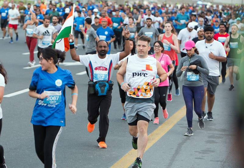 Dubai, United Arab Emirates - Participants from all walks of life running at the Dubai 30x30 Run at Sheikh Zayed Road.  Leslie Pableo for The National