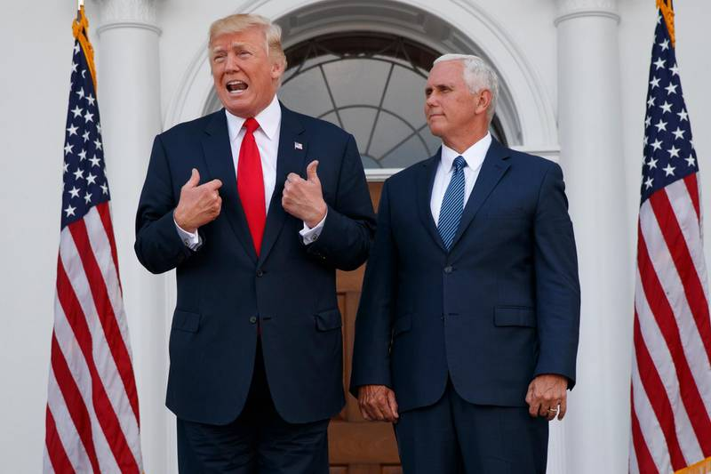 President Donald Trump, accompanied by Vice President Mike Pence, speaks to reporters before a security briefing at Trump National Golf Club in Bedminster, N.J., Thursday, Aug. 10, 2017,  (AP Photo/Evan Vucci)