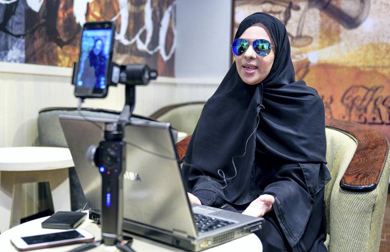 Abu Dhabi, United Arab Emirates, July 1, 2019.   Amal Al Mansouri, an Emirati girl of determination and a cartoon dubbing artist, whose work was praised during the Special Olympics World Games in Abu Dhabi earlier this year. --  Amal dubbing a cartoon to the Arabic language using her laptop. Victor Besa/The National Section:  NA Reporter:  Ruba Haza