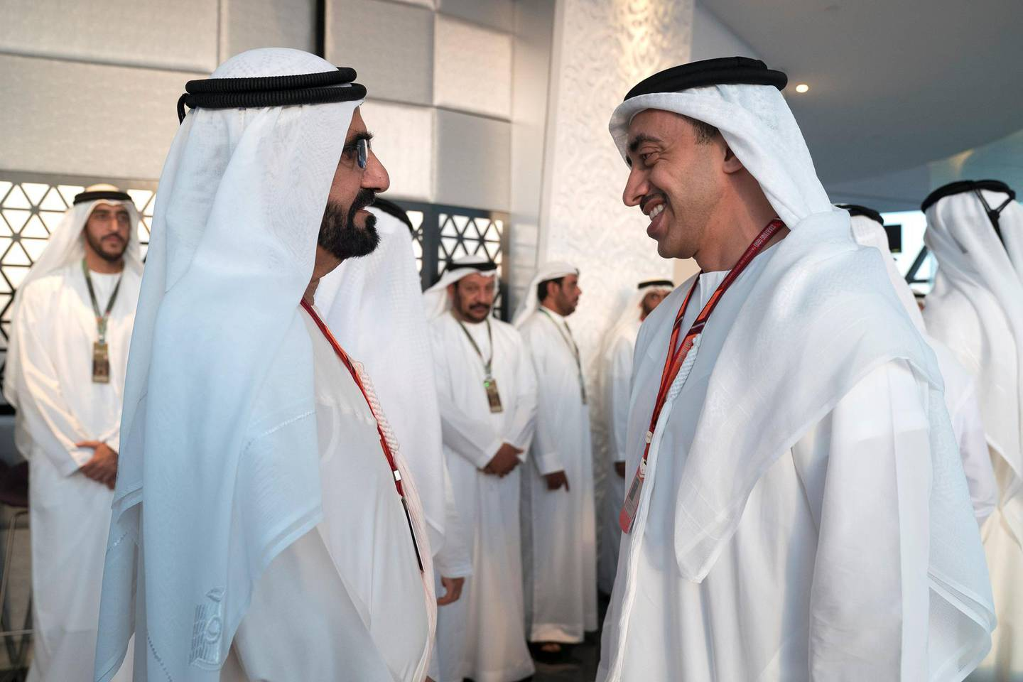 YAS ISLAND, ABU DHABI, UNITED ARAB EMIRATES - November 26, 2017: HH Sheikh Mohamed bin Rashid Al Maktoum, Vice-President, Prime Minister of the UAE, Ruler of Dubai and Minister of Defence (L) speaks with HH Sheikh Abdullah bin Zayed Al Nahyan, UAE Minister of Foreign Affairs and International Cooperation (R), on the final day of  Formula 1 Etihad Airways Abu Dhabi Grand Prix, at Shams Tower.   ( Omar Al Askar  for The Crown Prince Court - Abu Dhabi ) ---