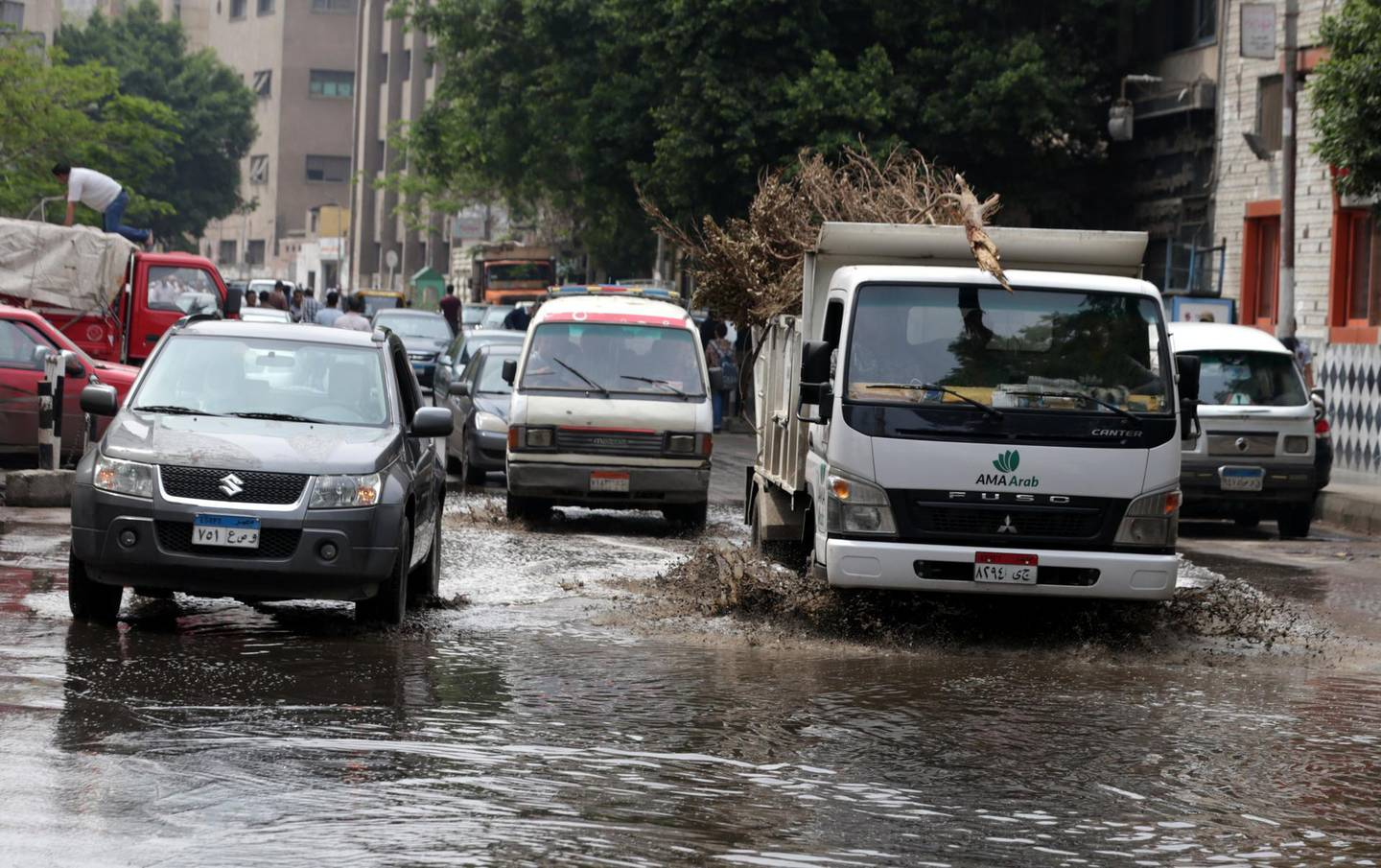 epa06693760 Cars drive through a flooded street after a flash flood affected Cairo, Egypt, 26 April 2018. Recent rainfalls have flooded parts of Egypt, temperatures dropped to six degrees Celsius.  EPA/KHALED ELFIQI