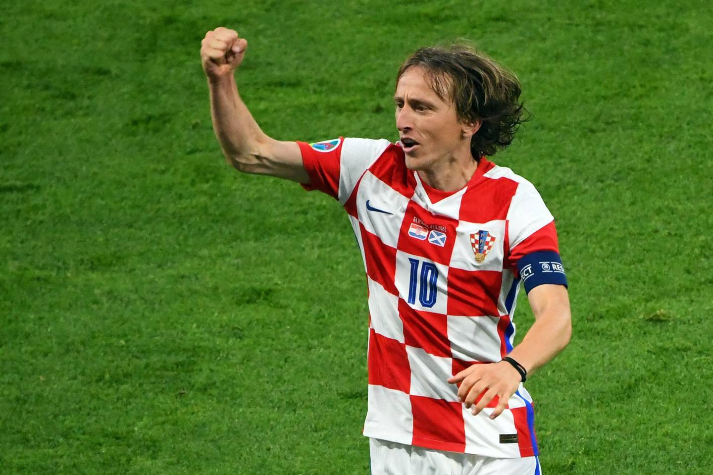 Croatia's midfielder Luka Modric celebrates with the fans after their win in the UEFA EURO 2020 Group D football match between Croatia and Scotland at Hampden Park in Glasgow on June 22, 2021. / AFP / POOL / ANDY BUCHANAN