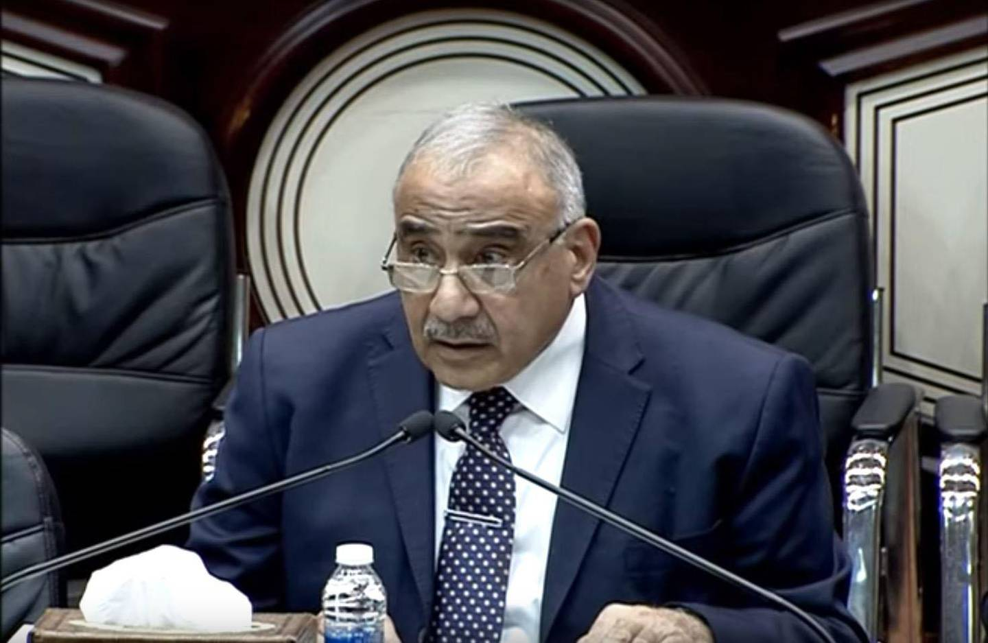 A screenshot from Youtube video uploaded by the Iraqi Parliament showing Prime Minister Adel Abdul Mahdi speaking at the parliament.