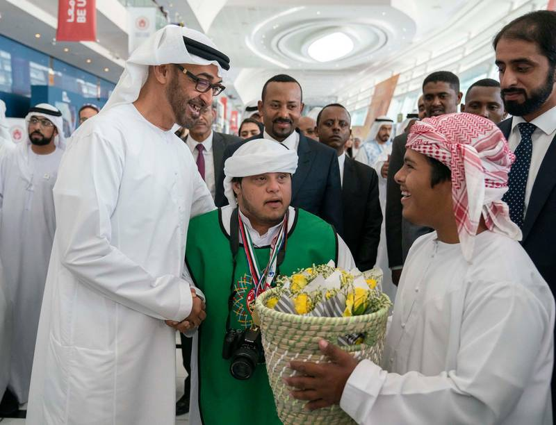 ABU DHABI, UNITED ARAB EMIRATES - March 18, 2019: HH Sheikh Mohamed bin Zayed Al Nahyan, Crown Prince of Abu Dhabi and Deputy Supreme Commander of the UAE Armed Forces (L) and HE Abiy Ahmed, Prime Minister of Ethiopia (back C), tour the Special Olympics World Games Abu Dhabi 2019, at Abu Dhabi National Exhibition Centre (ADNEC).  ( Ryan Carter / Ministry of Presidential Affairs )? ---