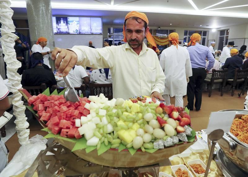 Dubai, United Arab Emirates - May 15, 2019: People take part in a multi faith Iftar at Gurunanak Darbar Sikh Gurudwara. Wednesday the 15th of May 2019. Jebel Ali, Dubai. Chris Whiteoak / The National
