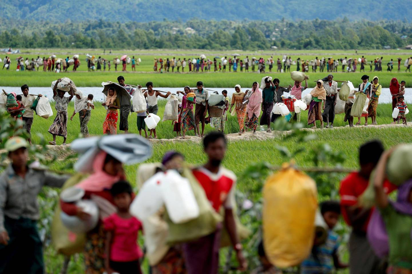 FILE PHOTO: Rohingya refugees, who crossed the border from Myanmar two days before, walk after they received permission from the Bangladeshi army to continue on to the refugee camps, in Palang Khali, near Cox's Bazar, Bangladesh October 19, 2017. To match Special Report MYANMAR-ROHINGYA/BATTALIONS     REUTERS/Jorge Silva/File Photo