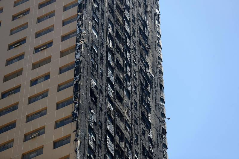 Sharjah, United Arab Emirates - Reporter: N/A: Fire. General View of Abbco Tower after a massive fire last night. Wednesday, May 6th, 2020. Sharjah. Chris Whiteoak / The National