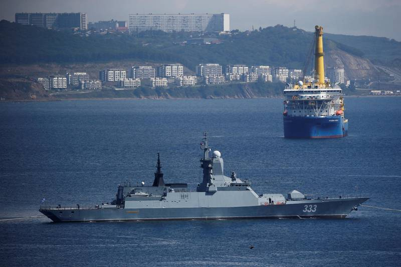 FILE PHOTO: The Russian navy corvette Sovershenny and the Gazprom owned pipe-laying ship Akademik Cherskiy are seen offshore Vladivostok, Russia September 6, 2017. Picture taken September 6, 2017. REUTERS/Sergei Karpukhin/File Photo