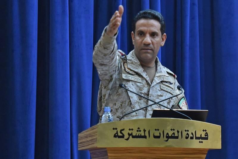 Spokesman of the Saudi-led military coalition Colonel Turki al-Maliki gestures during a press conference in the Saudi capital Riyadh, on September 16, 2019. The weapons used to strike two Saudi oil plants were provided by the kingdom's arch-foe Iran, the spokesman of the Riyadh-led coalition fighting in Yemen said. The Tehran-backed Huthi rebels in Yemen, where a coalition is bogged down in a five-year war, claimed the September 14 strikes on two facilities in Saudi Arabia, owned by state energy giant Aramco, which sent shock waves across oil markets. / AFP / Fayez Nureldine