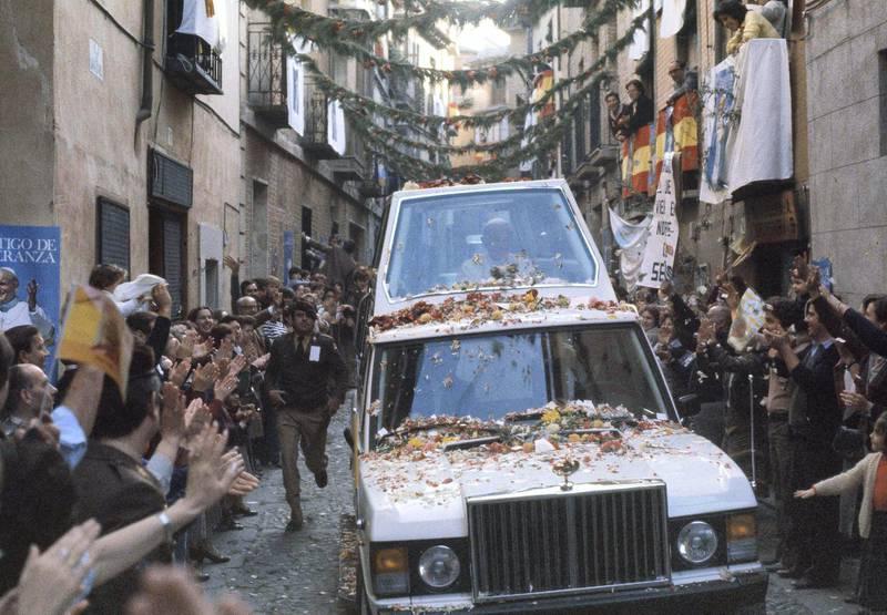 Pope John Paul II rides along a narrow street in his bullet-proof Popemobile in Toledo, Spain, Nov. 2, 1982. (AP Photo)