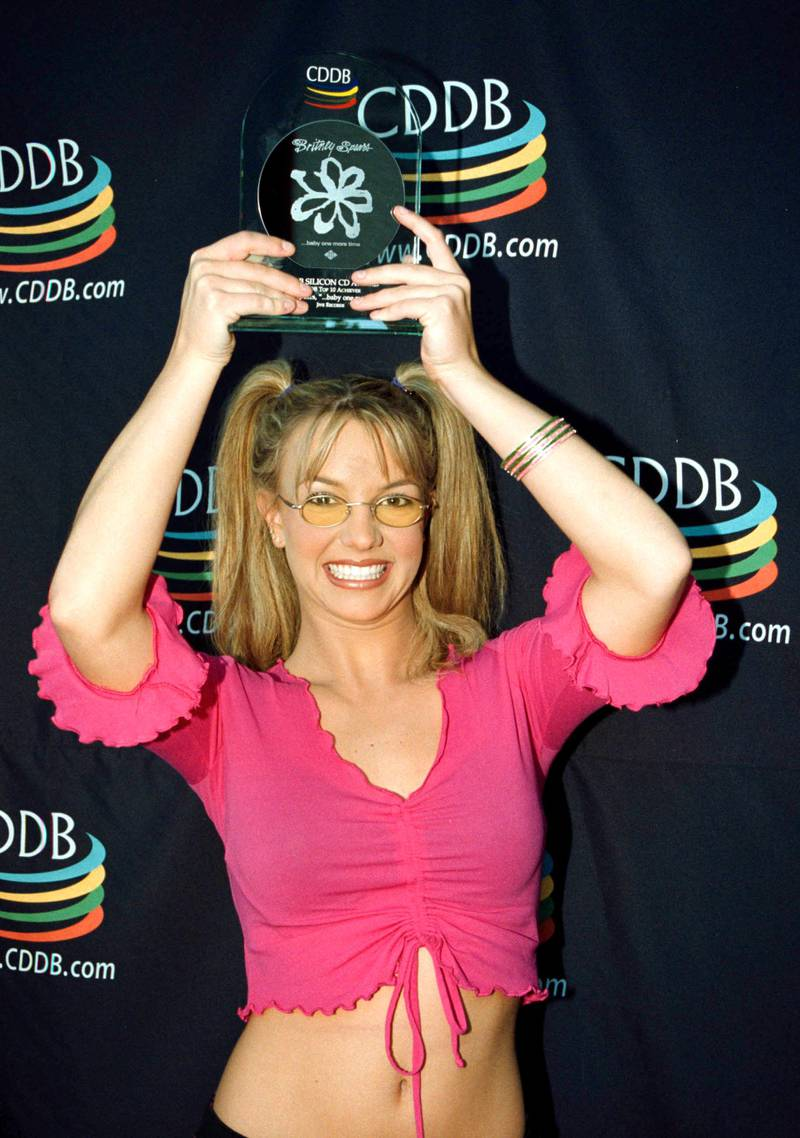 """Britney Spears Goes Silicon On The Internet! Britney Was All Hugs And Kisses When She Was Surprised With The Silicon Cd Award Presented By Cddb For Her Album """"Baby One More Time..."""" Which Advanced Into The Top Ten Albums Played On Computers In The World. Britney Was So Pleased That She Is As Popular Online As She Is In Stores And On The Radio That She Smooched The Laser-Etched Silicon Wafer. Just As The Riaa Certifies Artists Gold Or Platinum Based On The Number Of Records Sold, Cddb Certifies Albums Silicon Based On The Number Of Playson Computers. In Order To Go Silicon, An Artist Must Chart On The Digital Top 10 For A Period Of Thirty Days Or More. Media Contact: Eric Schwartzman Schwartzman And Associates (310) 452-3003  (Photo By Getty Images)"""