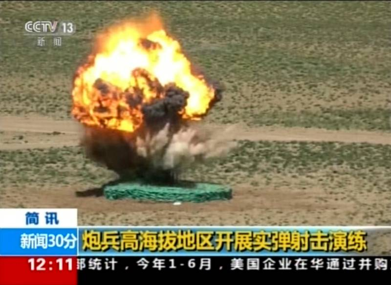 """In this image taken from a recent video footage run by China's CCTV on Friday, Aug 4, 2017, a target explodes during a live-fire drill by the Chinese army in China's Tibet Autonomous Region that border India. Beijing is intensifying its warnings to Indian troops to get out of a contested region high in the Himalayas where China, India and Bhutan meet, saying China has been restrained but """"restraint has its limits."""" Chinese characters in yellow reads """"Artillery soldiers high altitude live fire drills"""". (CCTV via AP)"""