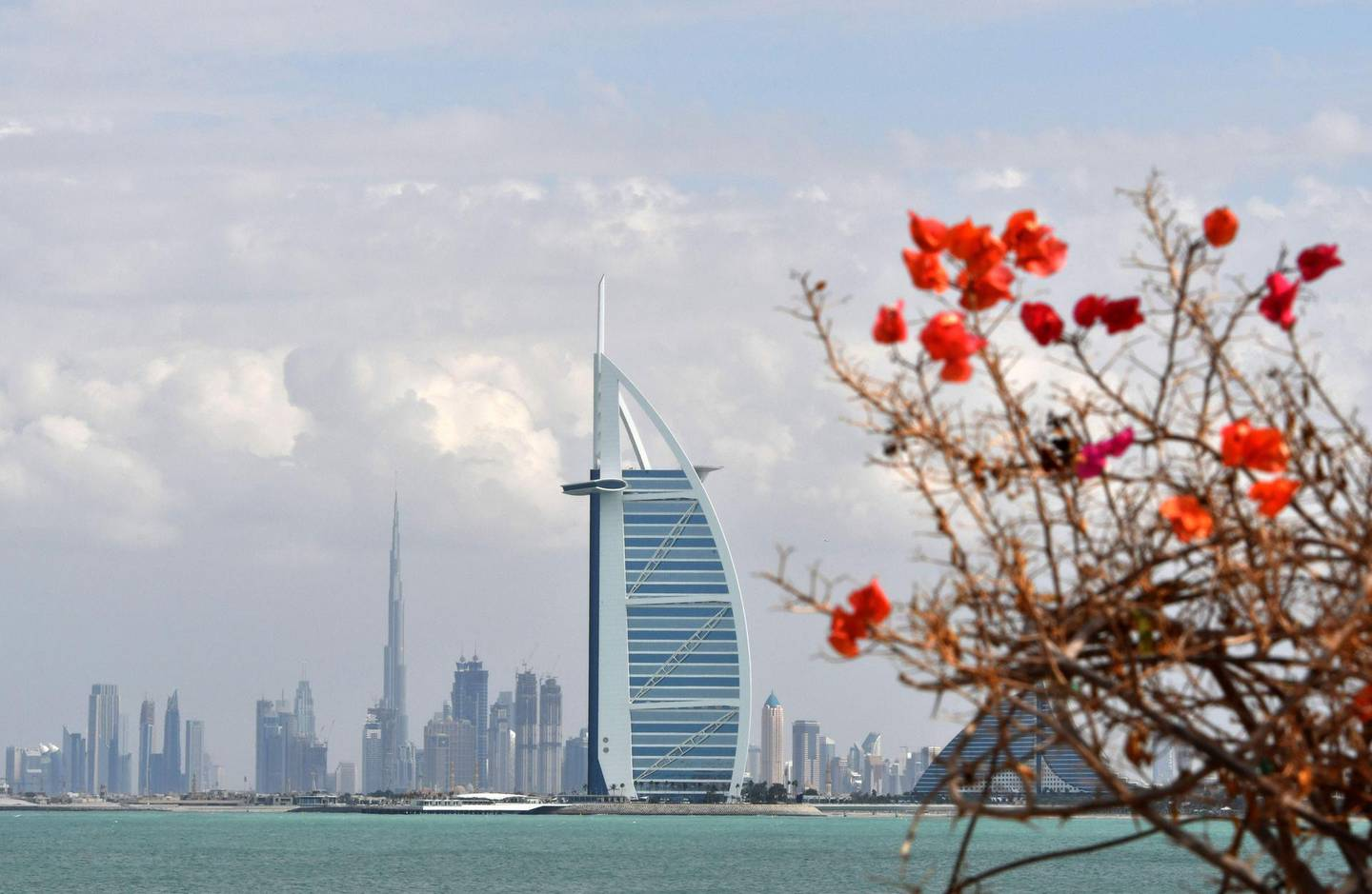 TOPSHOT - A picture taken on January 8, 2018 shows the skyline of Dubai with the Burj al-Arab in the foreground and Burj Khalifa (L) in the background.  / AFP PHOTO / GIUSEPPE CACACE