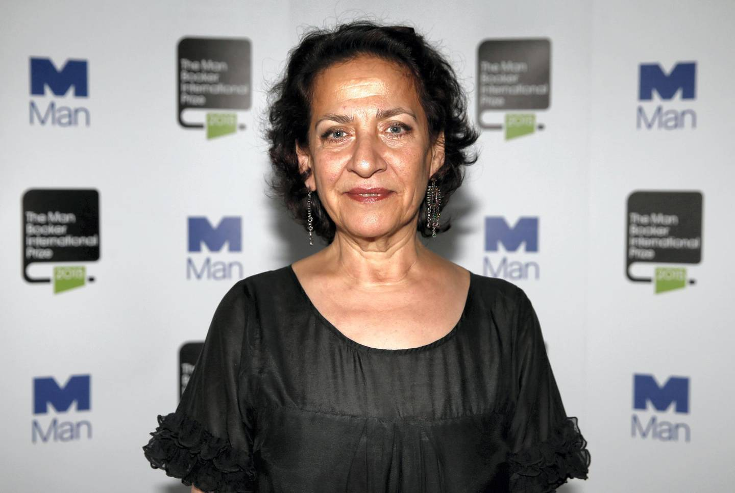Lebanese writer Hoda Barakat, one of the ten finalists for the 2015 Man Booker International Prize poses for a photograph at the Victoria and Albert Museum in London on May 19, 2015, ahead of tonight's award announcement. The £60,000 prize, awarded every two years, highlight's one writer's contribution to fiction on the world stage.   AFP PHOTO / ADRIAN DENNIS (Photo by ADRIAN DENNIS / AFP)