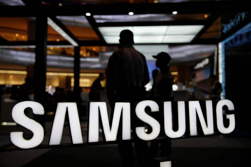 A customer stands near Samsung logo during Galaxy Note 8 consumer launch event in Jakarta, Indonesia September 29, 2017. REUTERS/Beawiharta