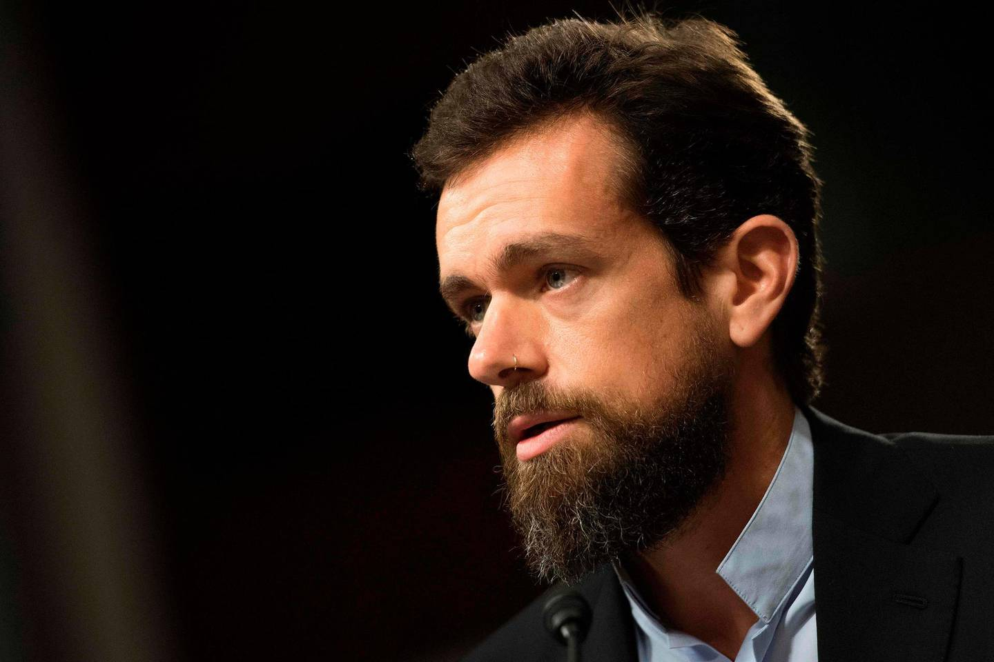 """(FILES) In this file photo taken on September 05, 2018 CEO of Twitter Jack Dorsey testifies before the Senate Intelligence Committee on Capitol Hill in Washington, DC. Twitter chief Jack Dorsey backed on January 13, 2021, its ban of US President Donald Trump, but said it sets a """"dangerous"""" precedent and represents a failure to promote healthy conversation on the platform / AFP / Jim WATSON"""