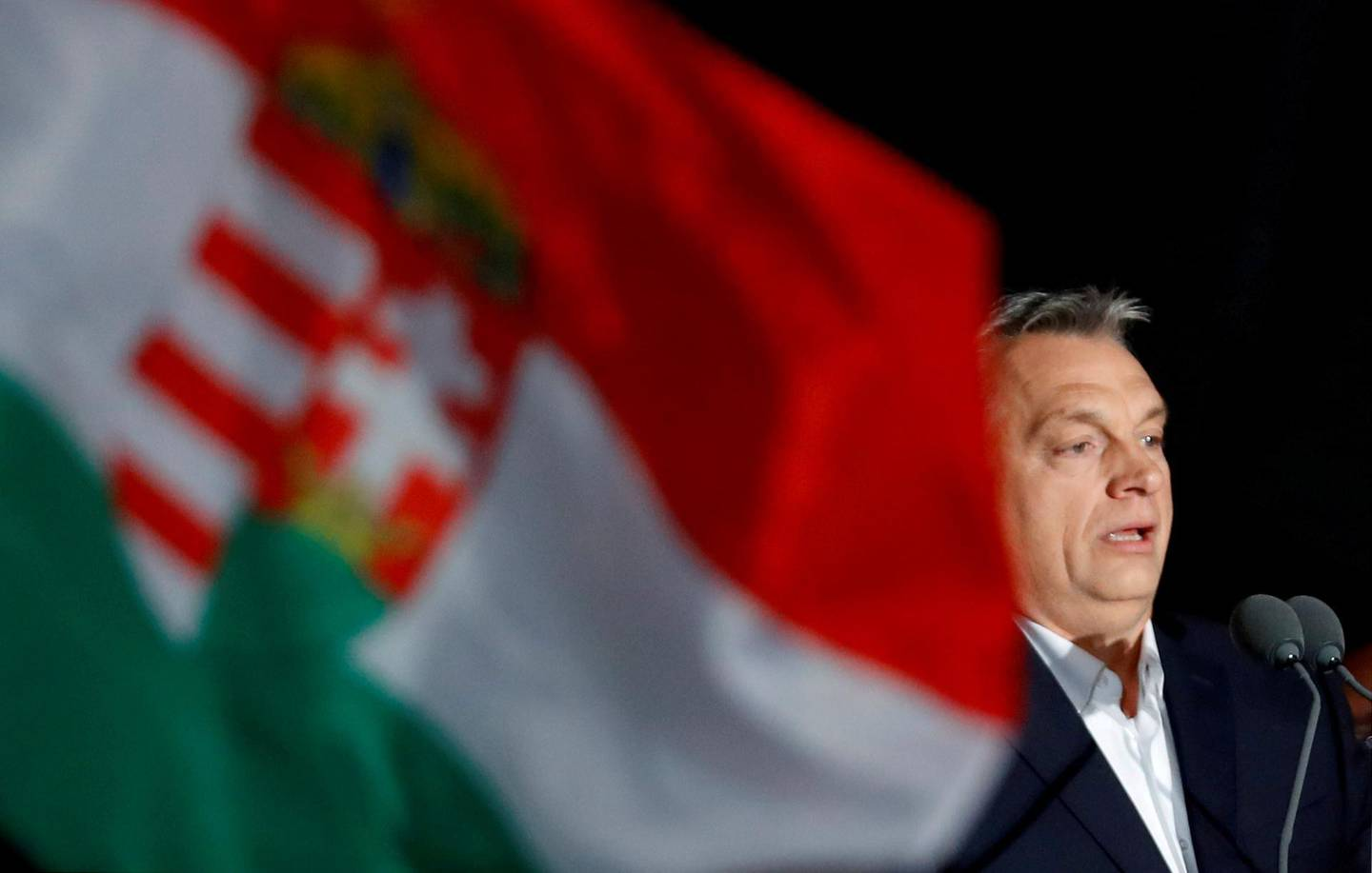 FILE PHOTO: FILE PHOTO: Hungarian Prime Minister Viktor Orban addresses the supporters after the announcement of the partial results of parliamentary election in Budapest, Hungary, April 8, 2018.REUTERS/Leonhard Foeger/File Photo