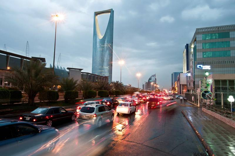 Traffic passes the Kingdom Tower, left, on King Fahad Road in Riyadh, Saudi Arabia, on Monday, April 9, 2012. Saudi Arabia's gross domestic product expanded 6.64 percent in the fourth quarter from a year ago, the kingdom's statistics agency said. Photographer: Waseem Obaidi/Bloomberg