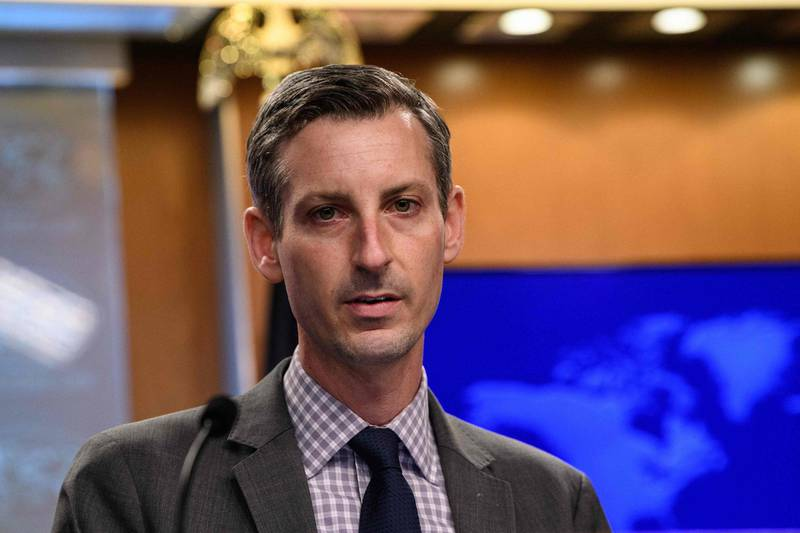 """(FILES) In this file photo US State Department spokesman Ned Price speaks during the daily press briefing at the State Department in Washington, DC, on February 25, 2021. The United States said on April 6, 2021 that initial talks by its partners in Vienna on Iran were """"constructive"""" as President Joe Biden looks for ways to rejoin a 2015 nuclear deal.""""We do see this as a constructive and certainly welcome step,"""" State Department spokesman Ned Price told reporters, while noting that the United States has not directly participated.  / AFP / POOL / NICHOLAS KAMM"""