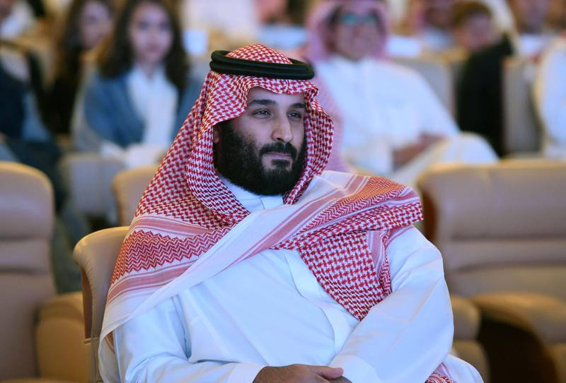 """(FILES) This file photo taken on October 24, 2017 shows Saudi Crown Prince Mohammed bin Salman attending the Future Investment Initiative (FII) conference in Riyadh. Saudi crown prince Mohammed bin Salman's aggressive power grab represents a huge gamble on the stability of his kingdom and its neighbors, but Donald Trump is not one to worry. The Washington foreign policy establishment may be agog at the young leader's """"anti-corruption"""" purge of potential foes within the Saudi elite, but the US government barely flinched. No one is quite sure whether MBS' bold move will leave him as the uncontested leader of a more modern, open Saudi Arabia -- or open the door to chaos, rebellion or a regional war.  / AFP PHOTO / FAYEZ NURELDINE"""