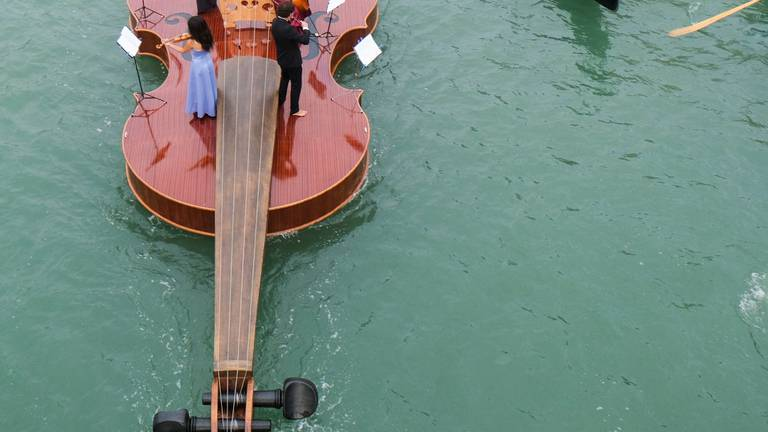An image that illustrates this article Watch a string quartet perform on a giant floating violin in Venice