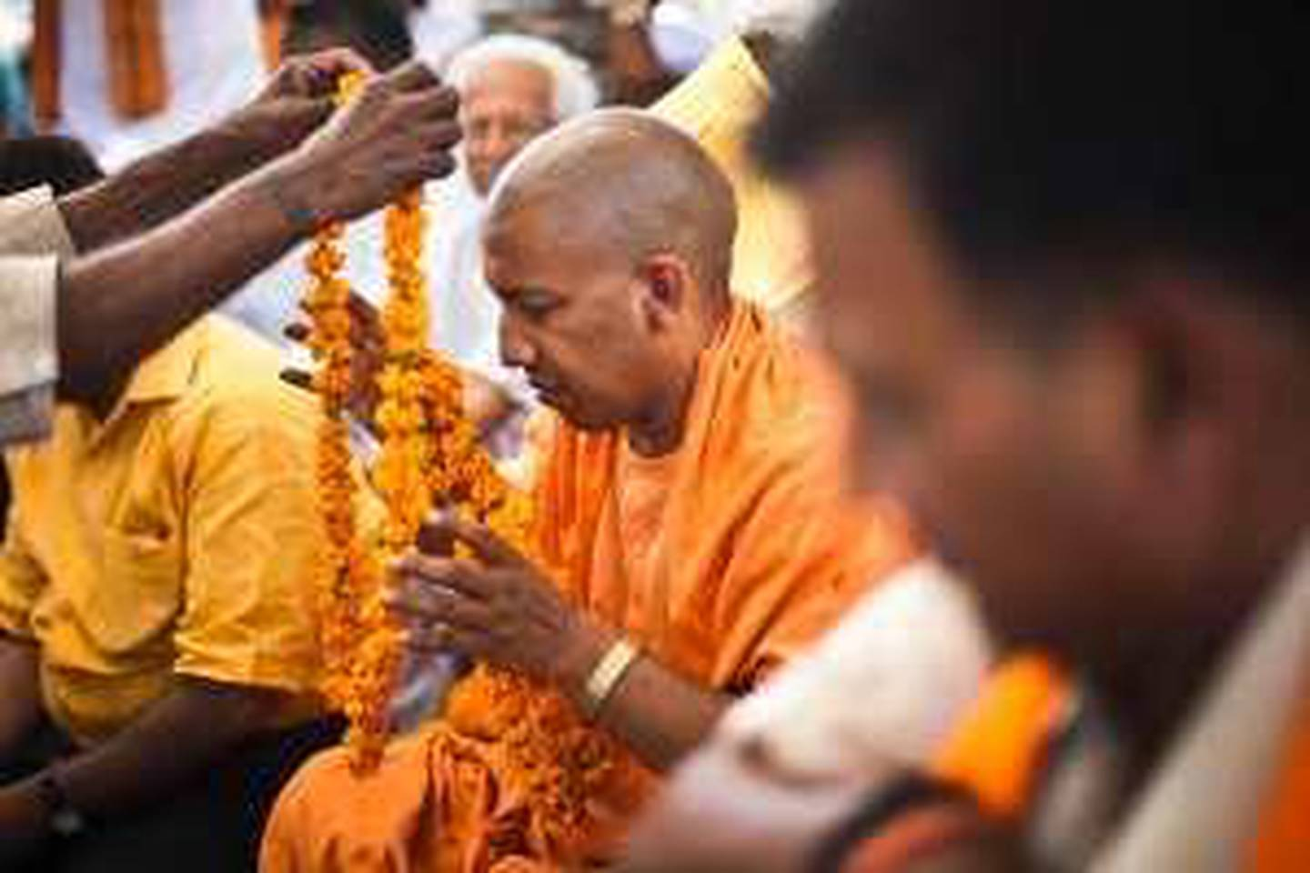 Bharatiya Janta Party's candidate, and minister of parliament, Yogi Adityanath is welcomed with garlands by the gathered audience in villages during his campaign in the outskirts of Gorakhpur, Uttar Pradesh, India. Photograph: Sanjit Das for The National