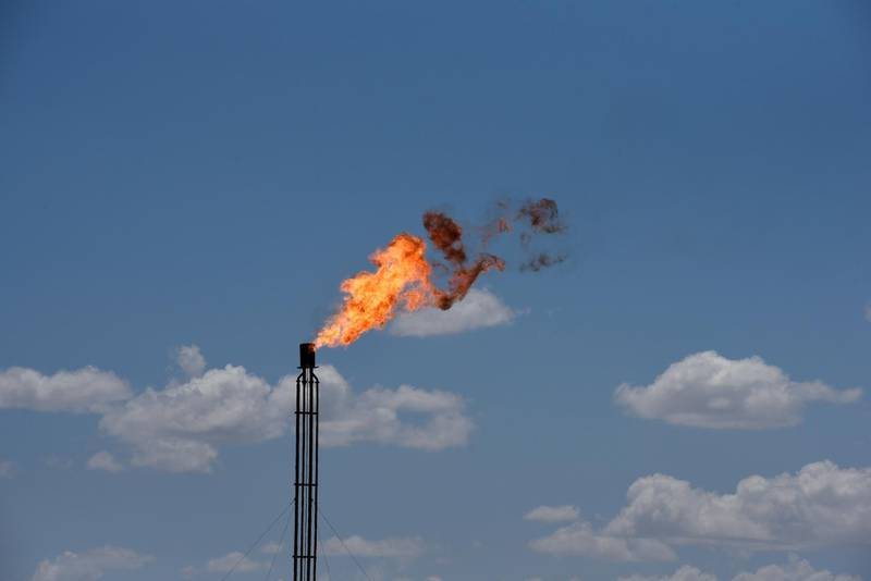FILE PHOTO: A flare burns off excess gas from a gas plant in the Permian Basin oil production area near Wink, Texas U.S. August 22, 2018. Picture taken August 22, 2018. REUTERS/Nick Oxford/File Photo
