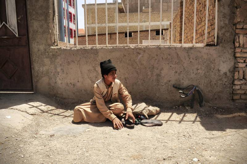 Pictured: Shahwali, 15, shines shoes for a living on the streets of Herat. He and his family were forced to leave their village when the drought meant work, food and water all dried up. He now lives in an unofficial IDP camp in Herat, Afghanistan. Photo by Charlie Faulkner May 2021