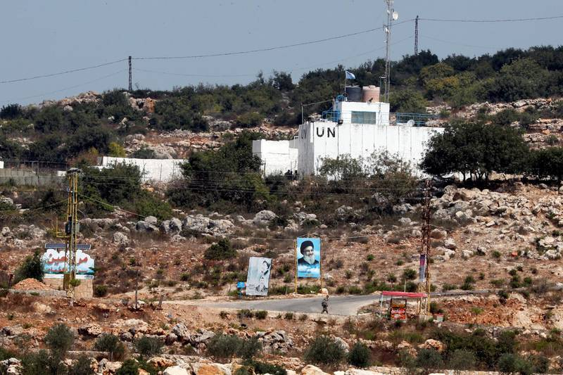 A banner depicting Hezbollah leader Sayyed Hassan Nasrallah and an United Nation's post are seen in Lebanon from the Israeli side of the border, near Zar'it in northern Israel August 28, 2019. REUTERS/Ammar Awad