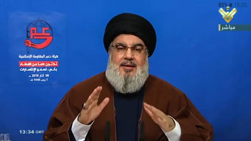 epa07422795 A TV grab handout photo from Hezbollah's al-Manar TV shows Hezbollah Secretary-General Sayeed Hassan Nasrallah as he delivers a speech on a big screen during a rally to mark the 30th anniversary of the establishment of the Islamic Resistance Support Association in southern suburb of Beirut, Lebanon, 08 March 2019.  EPA/AL-MANAR TV GRAB HANDOUT  HANDOUT EDITORIAL USE ONLY/NO SALES