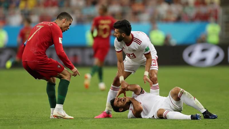 Soccer Football - World Cup - Group B - Iran vs Portugal - Mordovia Arena, Saransk, Russia - June 25, 2018   Portugal's Cristiano Ronaldo reacts as Iran's Morteza Pouraliganji is on the floor      REUTERS/Ivan Alvarado