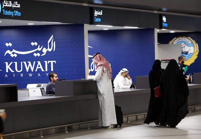 A picture taken on September 30, 2018, shows travellers checking-in at the new Terminal 4 of Kuwait International Airport, south of Kuwait City.  Kuwait Airways flights heading to neighbouring Gulf countries began taking off from the new terminal today. The itinerary includes between 26 to 34 daily trips to Gulf Cooperation (GCC) countries, the chairman of the company said.  / AFP / Yasser Al-Zayyat
