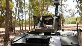 Israeli firm unveils armed robot to patrol borders