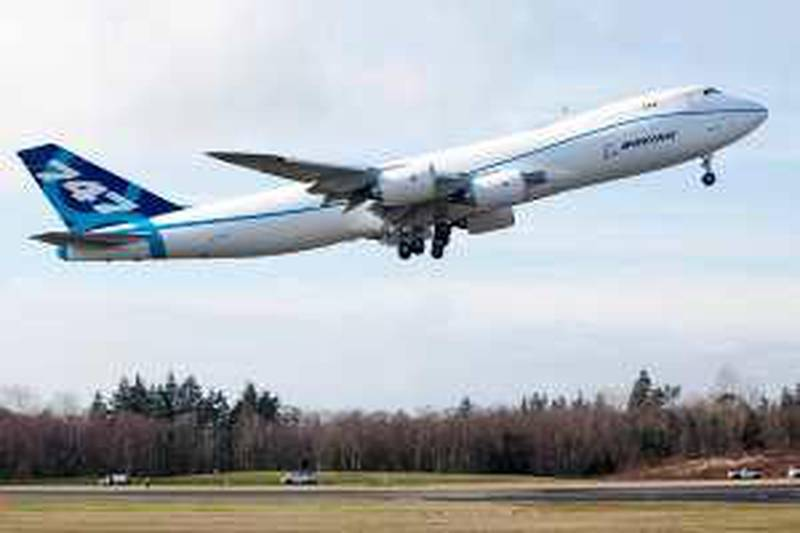 EVERETT, WA - FEBRUARY 8: The Boeing 747-8 freighter makes its first test flight February 8, 2009 at Paine Field in Everett, Washington. The 747-8 is the largest jumbo jet Boeing has built.   Stephen Brashear/Getty Images/AFP== FOR NEWSPAPERS, INTERNET, TELCOS & TELEVISION USE ONLY == *** Local Caption ***  807158-01-10.jpg *** Local Caption ***  807158-01-10.jpg