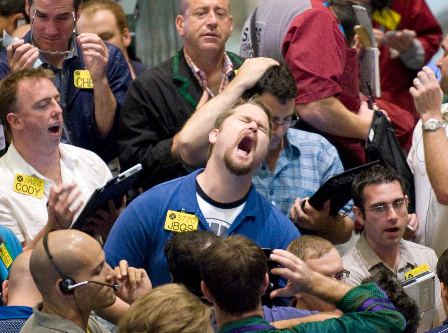 Traders work in the options pit at the New York Mercantile Exchange Thursday Aug. 21, 2008. Oil prices have rebounded after falling about $35, or nearly a quarter, from their all-time trading record $147.27 on July 11. (AP Photo/Richard Drew)