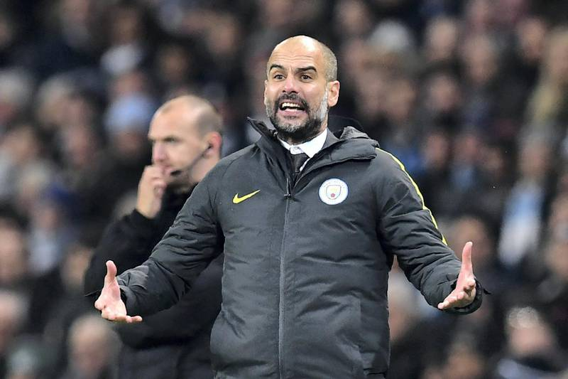 Manchester City's Spanish manager Pep Guardiola gestures on the touchline during the English Premier League football match between Manchester City and Arsenal at the Etihad Stadium in Manchester, north west England, on December 18, 2016. - Manchester City won the game 2-1. (Photo by Paul ELLIS / AFP) / RESTRICTED TO EDITORIAL USE. No use with unauthorized audio, video, data, fixture lists, club/league logos or 'live' services. Online in-match use limited to 75 images, no video emulation. No use in betting, games or single club/league/player publications. /