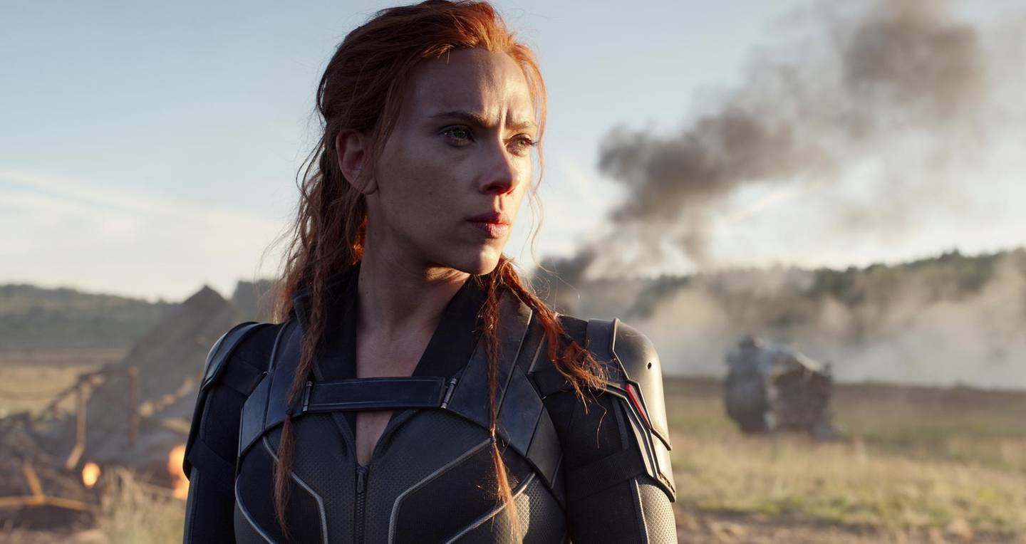 """This image released by Disney/Marvel Studios' shows Scarlett Johansson in a scene from """"Black Widow."""" The Walt Disney Co. on Friday overhauled its release schedule, moving the dates of half a dozen Marvel movies. """"Black Widow,"""" which had been set to kick off the summer movie season, will now open Nov. 6. (Marvel Studios/Disney via AP)"""