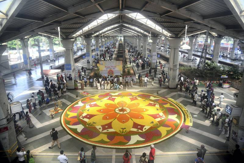NAVI MUMBAI, INDIA - SEPTEMBER 4: Floral Rangoli made on the occasion of Onam at Panvel Railway Station by Keraliya Cultural Society Panvel on September 4, 2017 in Navi Mumbai, India. Onam is an annual harvest festival of Kerala. The festival is mainly celebrated by Malayalees around the world with traditional folk dances, artworks, etc. According to the Onam story and its popular myth, Lord Vishnu in his Vamana avtar sents King Mahabali to hell as the gods becomes jealous of his popularity. But grants him a boon that the king can visit his subjects once in a year. Thus, it is believed that Onam is celebrated as King Mahabali's visit to the place. It is the only festival in which both the winner and the defeater are worshipped. Onam Festival falls during the Malayali month of Chingam (Aug - Sep) and marks the homecoming of legendary King Mahabali. Carnival of Onam lasts for ten days and brings out the best of Kerala culture and tradition. (Photo by Bachchan Kumar/ Hindustan Times via Getty Images)
