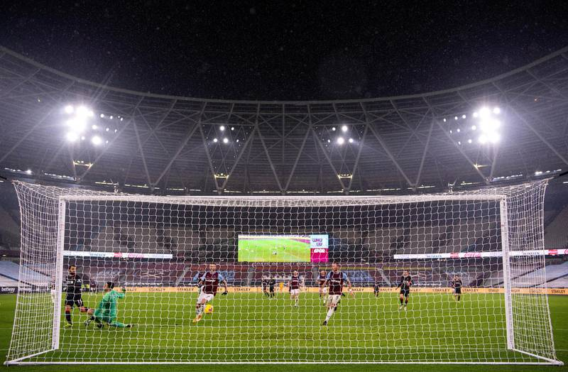 LONDON, ENGLAND - JANUARY 31: Mohamed Salah of Liverpool scores their side's second goal during the Premier League match between West Ham United and Liverpool at London Stadium on January 31, 2021 in London, England. Sporting stadiums around the UK remain under strict restrictions due to the Coronavirus Pandemic as Government social distancing laws prohibit fans inside venues resulting in games being played behind closed doors. (Photo by Justin Setterfield/Getty Images)