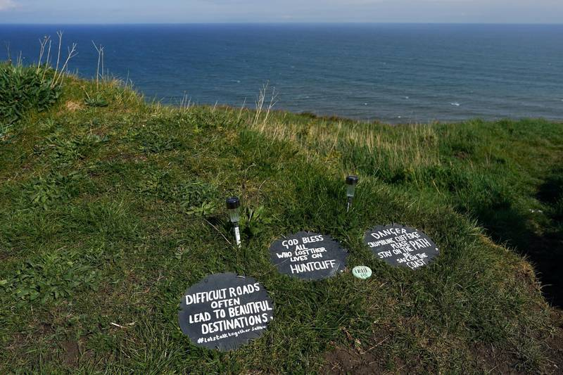 SALTBURN BY THE SEA, UNITED KINGDOM - MAY 01: Signs offering advice, reassurance and warnings are placed along a path that follows steep sea cliffs on the outskirts of Saltburn to support those who might be contemplating suicide on May 01, 2020 in Saltburn By The Sea, United Kingdom. The messages have been placed there by local man, Paul Waugh, a former Coastguard who has taken on the responsibility of trying to reduce the number of suicides along this stretch of sea cliffs. Increased social isolation, loneliness, health anxiety, economic pressures and stress are leading to increased concern for mental health issues during the Coronavirus pandemic. British Prime Minister Boris Johnson, who returned to Downing Street this week after recovering from Covid-19, said the country needed to continue its lockdown measures to avoid a second spike in infections. (Photo by Ian Forsyth/Getty Images)