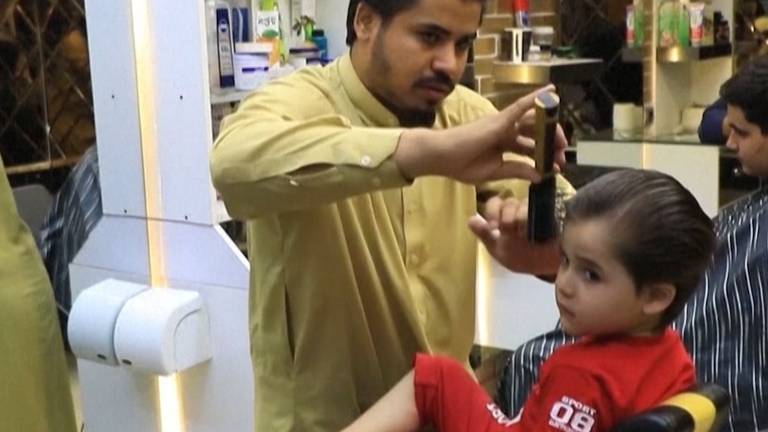 An image that illustrates this article Business declines for barbers under Taliban rule as Afghans shun fashion