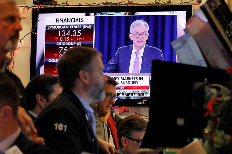 A television screen on the floor of the New York Stock Exchange shows Federal Reserve Board Chair Jerome Powell's Washington news conference, Wednesday, Dec. 11, 2019. The Federal Reserve is leaving its benchmark interest rate alone and signaling that it expects to keep low rates unchanged through next year. (AP Photo/Richard Drew)